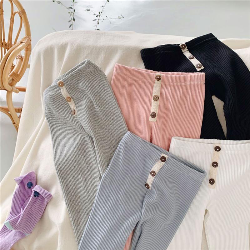 Recenti INS autunno bambini pantaloni della ragazza a costine leggings pulsanti frontali ghette dei bambini dei pantaloni di modo del progettista alla moda coreano del cotone dei capretti
