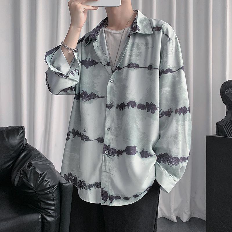 Camisa 2020 de primavera y otoño Nueva Juventud hombres populares de floja rayada larga impresa de manga ocasional de la manera camisa de un solo pecho
