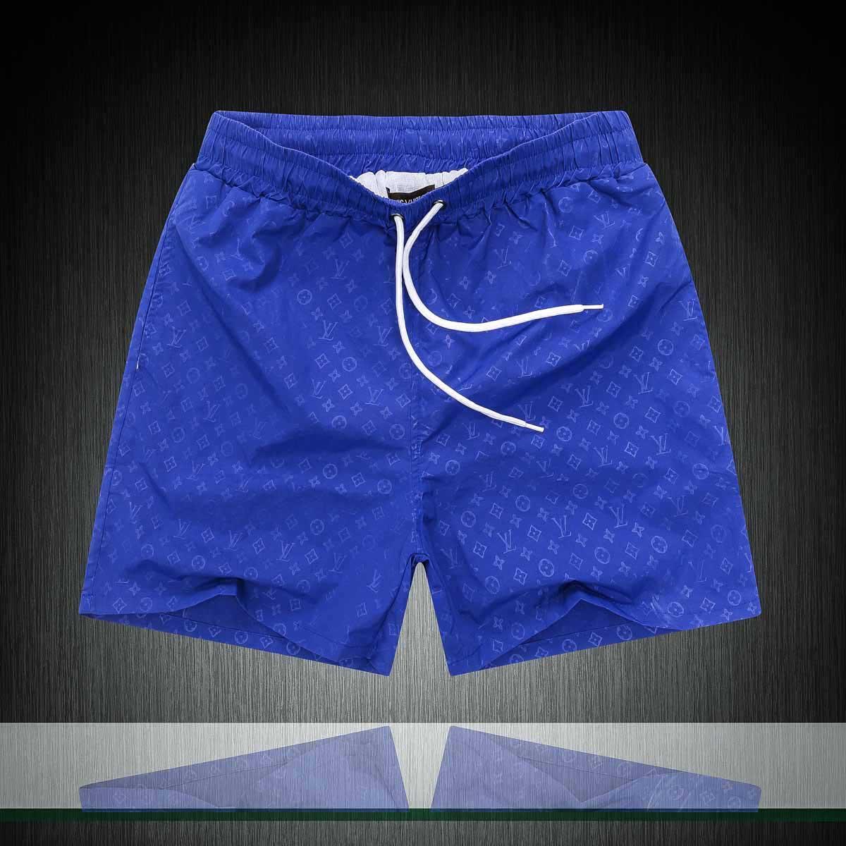 20nn Männer kurze Hosen-Männer Mode für den Sommer Strand Hosen Männer und Frauen Tarnung lose Shorts drucken Reißverschlussdekoration
