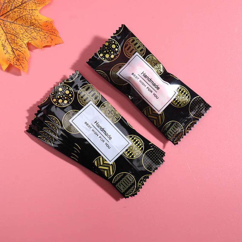 500pcs / серия Нуга Упаковочная сумка Golden Line Графические слова Домашнее Сахар пакет партии DIY конфеты подарочной упаковки молока Таффи Wrapper