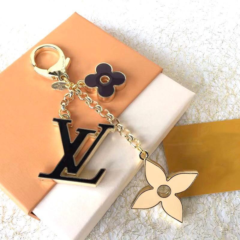 Squisito quattro foglie di fiore lettera lusso portachiavi Multi sacchetto ciondolo catena chiave di modo di fascino