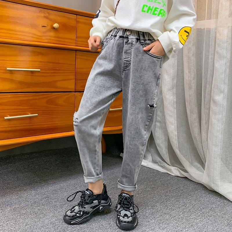 весна осень для девочек рваные брюки и джинсы 2020 новых средних и больших детей модные брюки Корейский стиль дымчато-серые джинсы