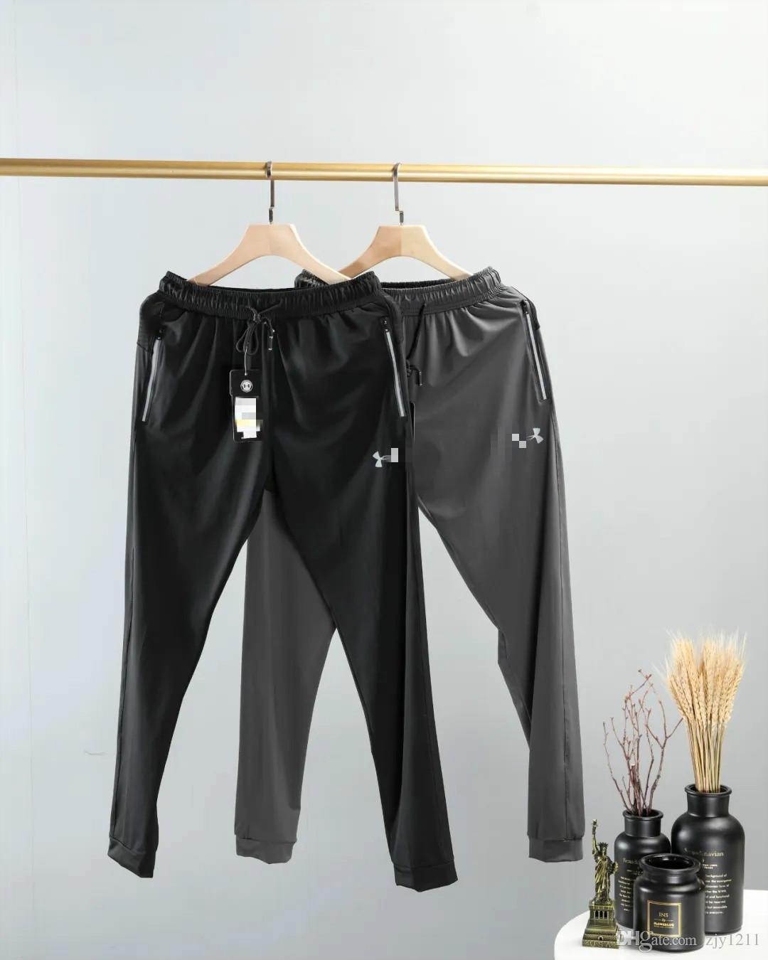 2020 yeni erkek tasarımcı pantolon rahat spor çabuk kuruyan streç pantolon pantolon çok yönlü yansıtıcı logo ve cep 3M Hafif