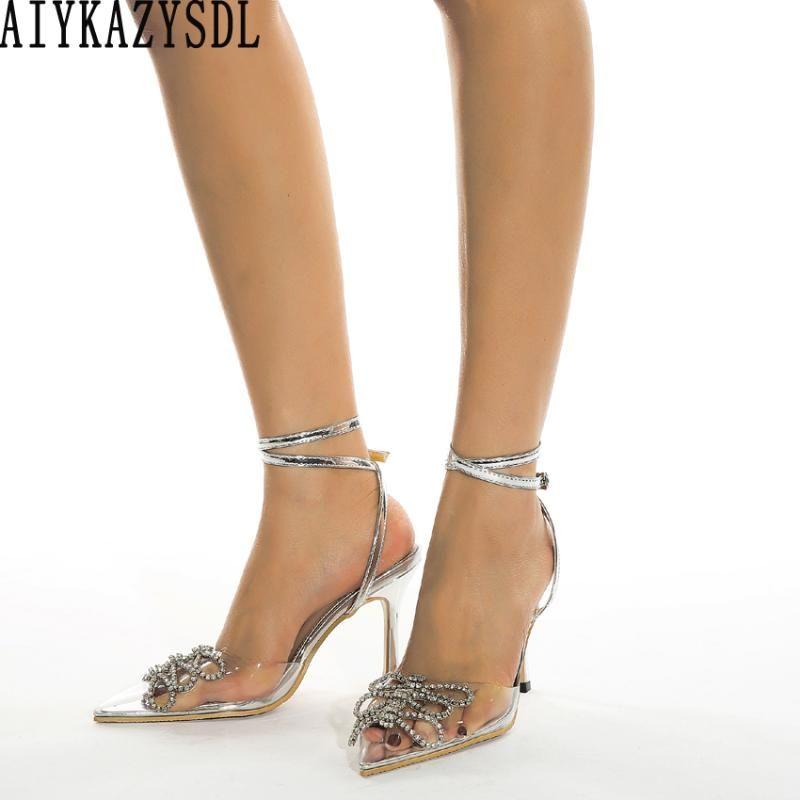AIYKAZYSDL Femmes Pompes Crystal Clear Hauts talons strass Bow Chaussures de mariage avec boucle cheville Stiletto Rome Sandales Party 2020