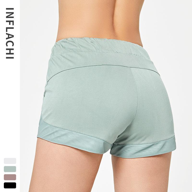 Las mujeres elásticos de la cintura de la capa doble Casual Pantalones cortos para correr con bolsillos laterales de entrenamiento de gimnasio de secado rápido pantalones cortos deportivos