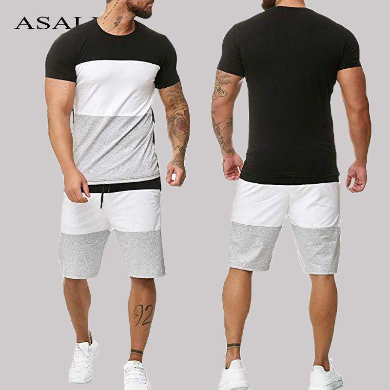 Trajes de verano deporte de la pista 2 Piezas camisetas cortocircuito los sistemas de la manga corta para hombre de la manera ocasional del chándal de deporte masculino de rayas