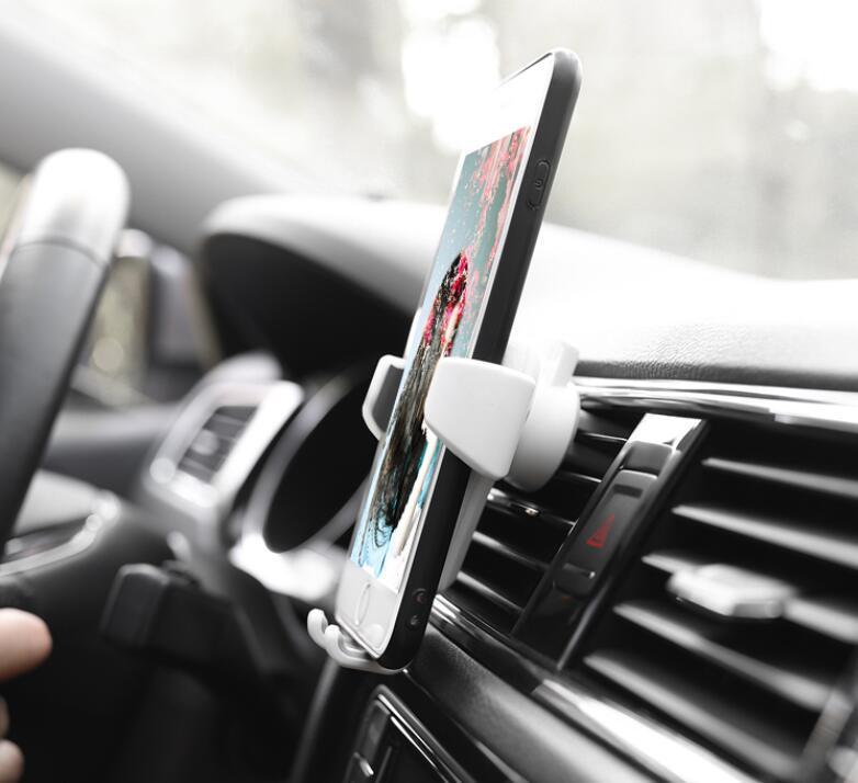 Vender titular del teléfono del coche universal caliente Aire montaje de la salida del soporte para el teléfono en coche No Propietario de soporte del teléfono móvil magnético con el paquete al por menor