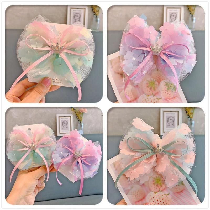 Boutique 12pcs clips de moda linda del brillo Tiaras Gradiente arco floral de las horquillas de la corona del Rhinestone del Bowknot del pelo de la princesa Headwear