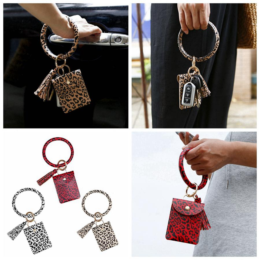 Armreif-Karten-Beutel-Mappen-Schlüsselanhänger Armband Keyring Leopard Handtasche Armband Kreditkarteninhaber mit Quaste Partei-Bevorzugung RRA3368
