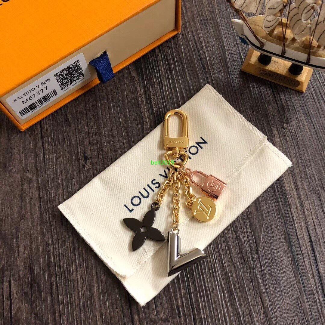 Unisex Schlüsselanhänger Hochwertiger Schlüsselanhänger Cirle Mode Autoschlüsselanhänger Männer Frauen Edelstahl-Charme-Schlüsselanhänger für Geschenk-Kasten T032