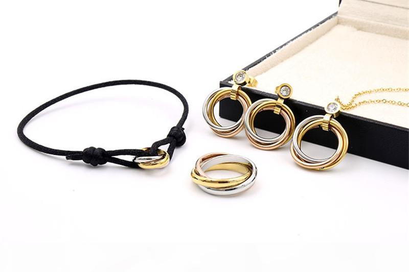 D Mujeres amante brazalete hecho a mano de la cuerda de la cadena de la pulsera del encanto de titanio de acero inoxidable tres círculos pulseras para las mujeres joyería
