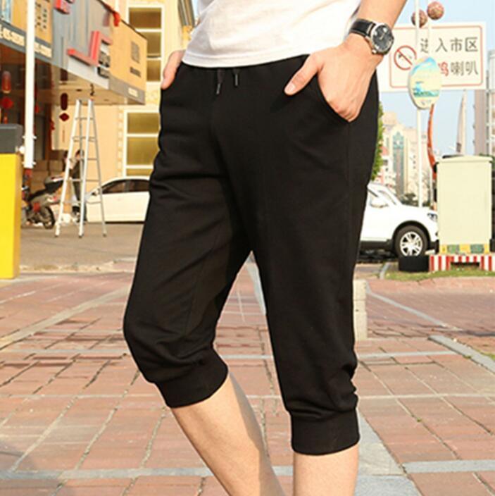 Novas Casual Jogger calças casuais Sweatpants Magro Bezerro de comprimento para homens jovens de algodão Meninos Pantalon mais o tamanho 4XL