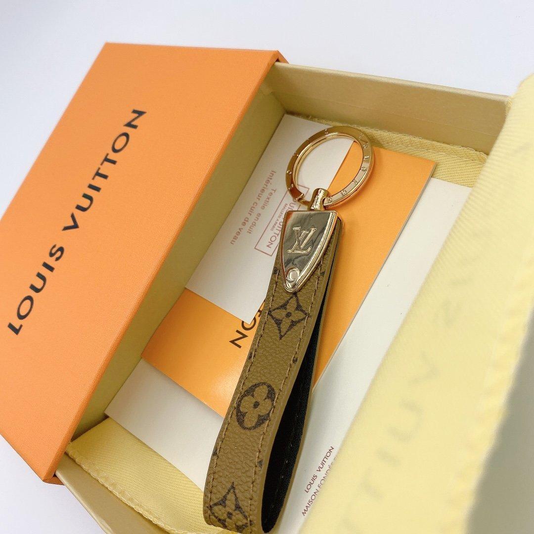 Con la caja europea y la clave diseñador estilo de la cadena de moda caliente elegante del oro de la cadena de primavera W1 llavero de la venta caliente de gama alta moda estadounidense