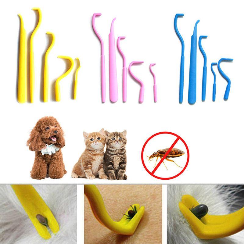 5pcs / Set Retiro de la señal gancho de clip Herramienta de eliminación de garrapatas del perro del gato Herramienta Selector de pulgas para mascotas peine portátil de alimentos para mascotas JK2005XB