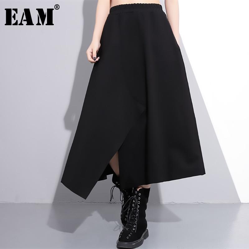 [EAM] 2020 nuevos resortes de alta elástico de la cintura Negro dobladillo irregular flojo Vent dobladillo grande de medio cuerpo de la falda de las mujeres manera de la marea JE52401M