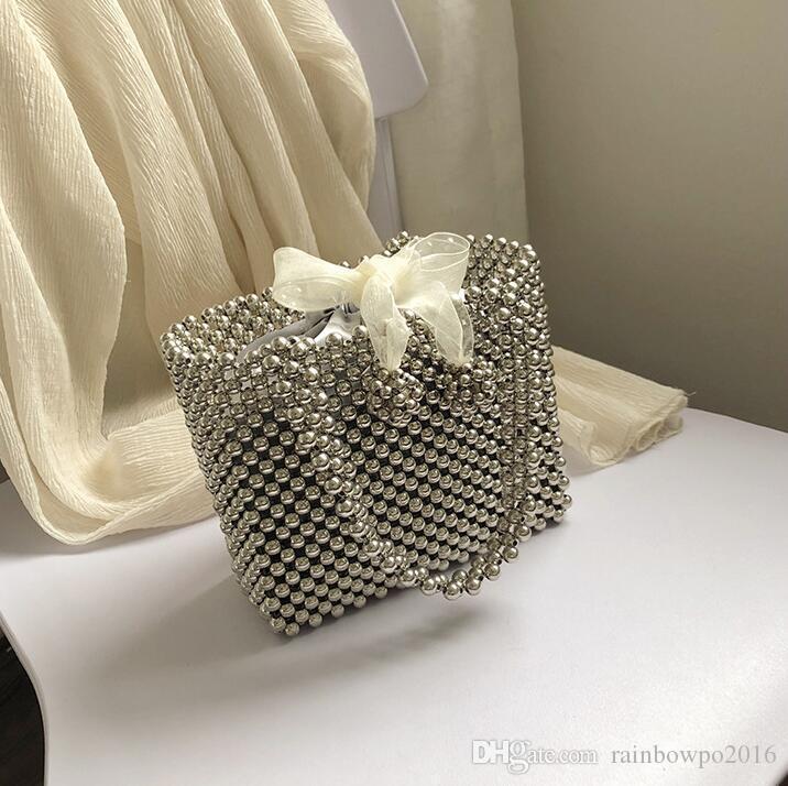 Factory outlet women handbag summer fashionable hollow beaded handbag personalized rivet metal bag sweet lady Pearl bow beach bag