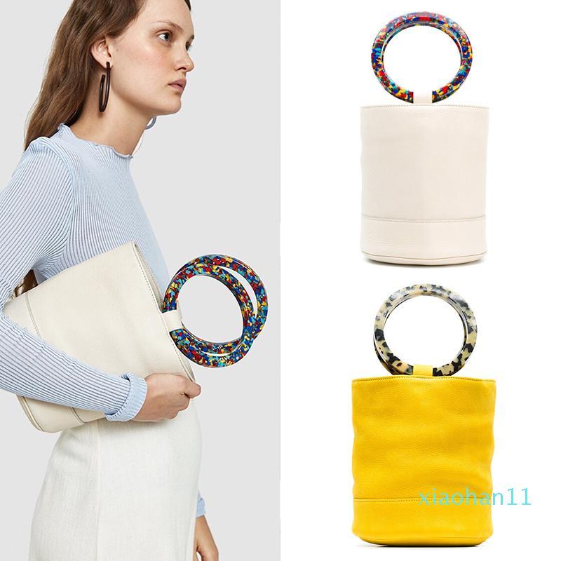 Pelle Nubuck di vendita calda Borsa Secchiello design Bonsai Bag Doppia resina del cerchio maniglia per il trasporto delle borse di cuoio del cerchio dell'anello Lady Handbags Grained