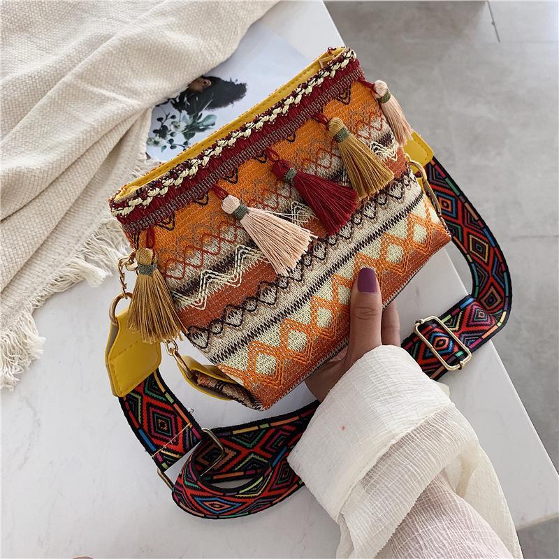 Estilo Nacional ancha correa de hombro del cubo bolsas borla de las mujeres monederos y los bolsos de mano del embrague bolsa de mensajero de las señoras de la Cruz Body Bags