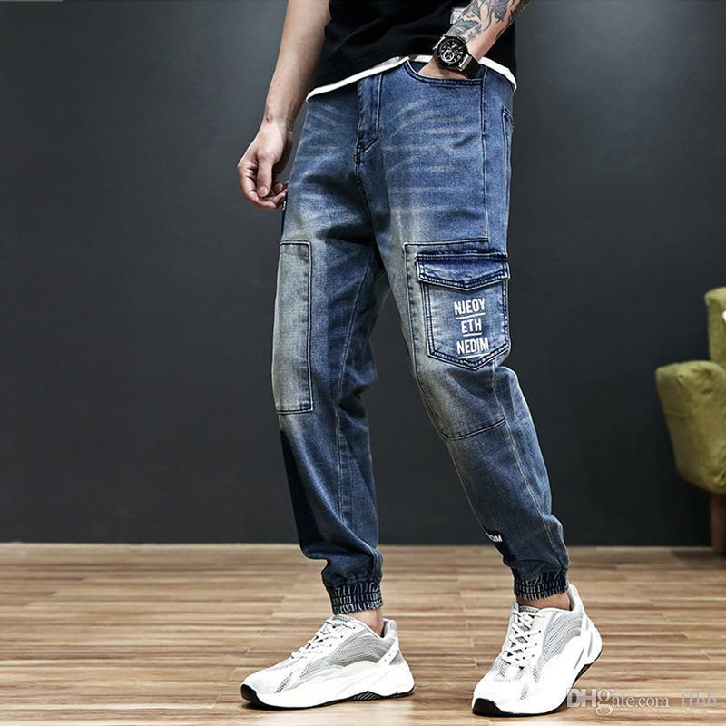 Moda Streetwear Uomo Jeans Loose Fit Big Pocket Denim Cargo Pants stampati Jeans Men Patch Designer Hip Hop Joggers Homme