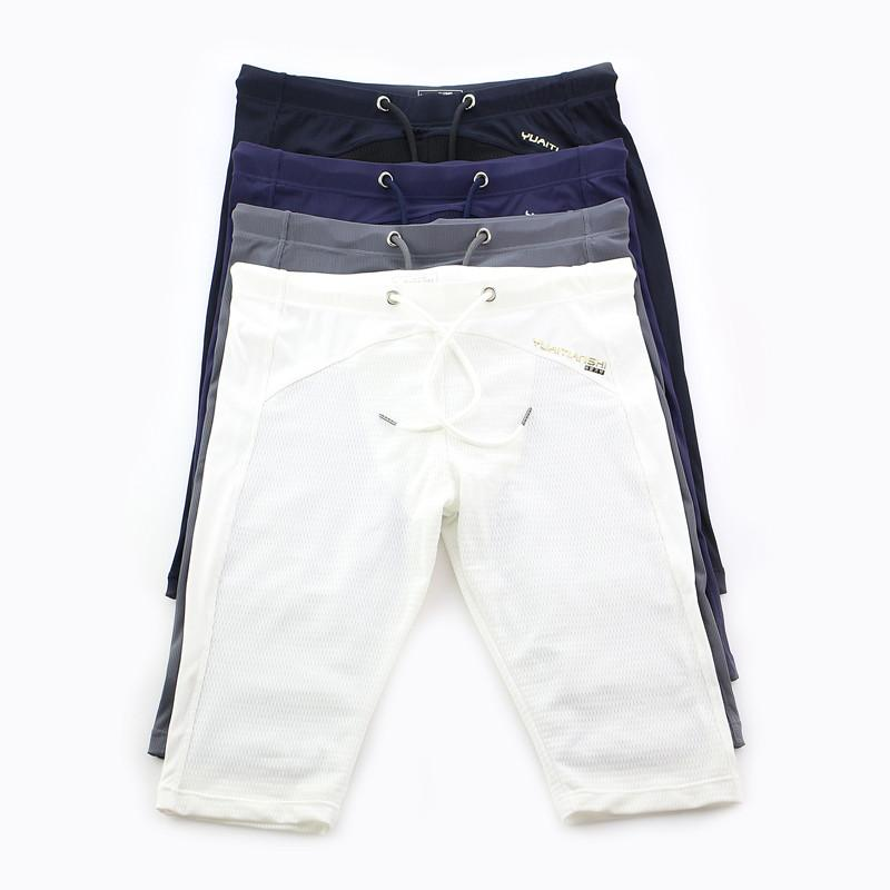 Los pantalones 4PCS / LOT hombres tabla corta ocasional del verano entrenamiento de culturismo verano Junta cortos de entrenamiento ajustados pantalones cortos aptitud de la gimnasia