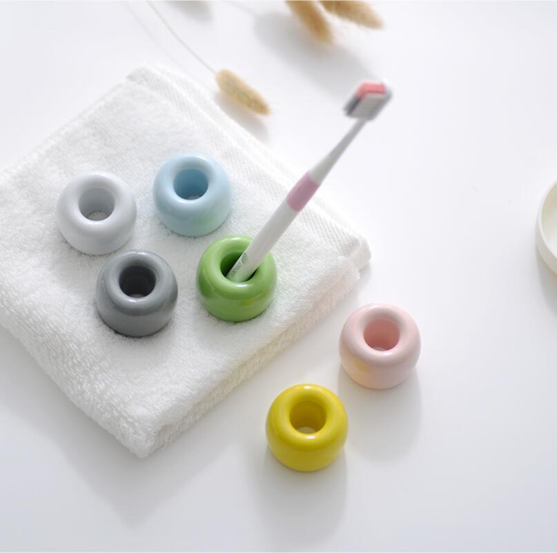 Cepillo de dientes creativo Tenedor de cepillos de cerámica Personalidad de moda Amantes simples Cepillos de dientes Titular