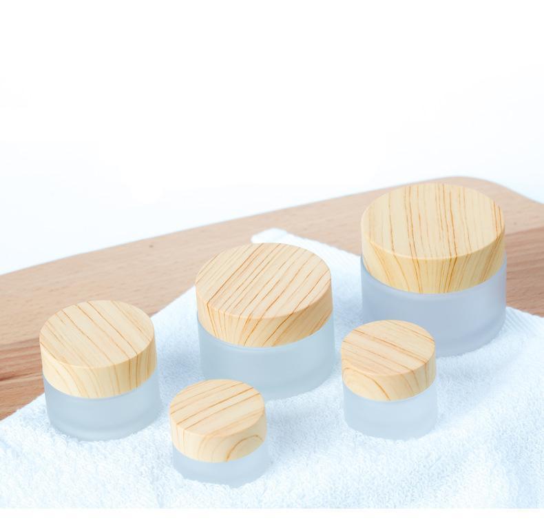 Vacie la olla de vidrio helada con la tapa de la tapa del grano de madera Cuidado de la piel Máscara de crema de la crema de los contenedores cosméticos Botella de recambio 5G 10G 15G 30G 50G YTP1249