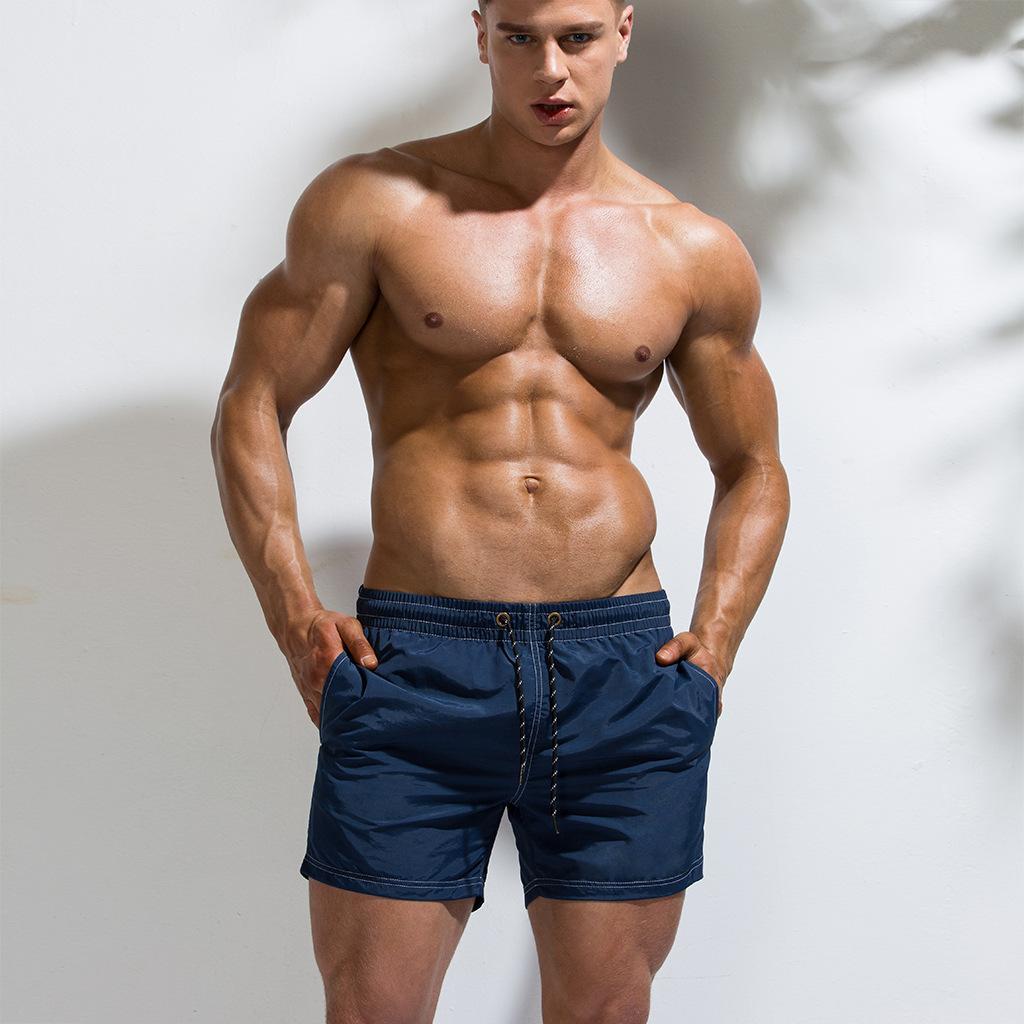 Pantalon à séchage rapide Short Beach Shorts d'homme Piscine solide Surf Beach Volleyball Hommes Shorts pantalons courts et boxers Pocket Gym Hot CX200711