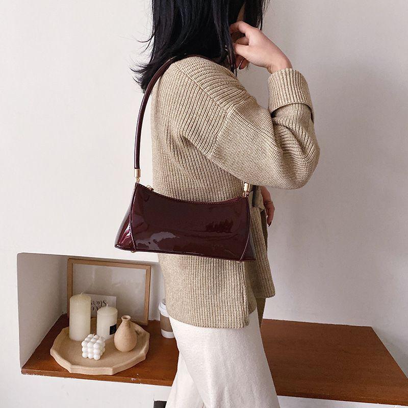 versione coreana moda casual 2020 delle donne nuova borsa a tracolla della borsa della borsa francese bastone ascella signore di colore solido