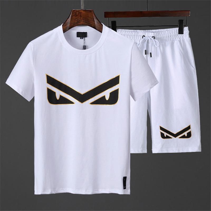 Nouveau mode vêtements taille d'été de vêtements pour hommes de sport de costume de jogging de manches courtes cou couple et les femmes rondes des hommes de sport M -3XL