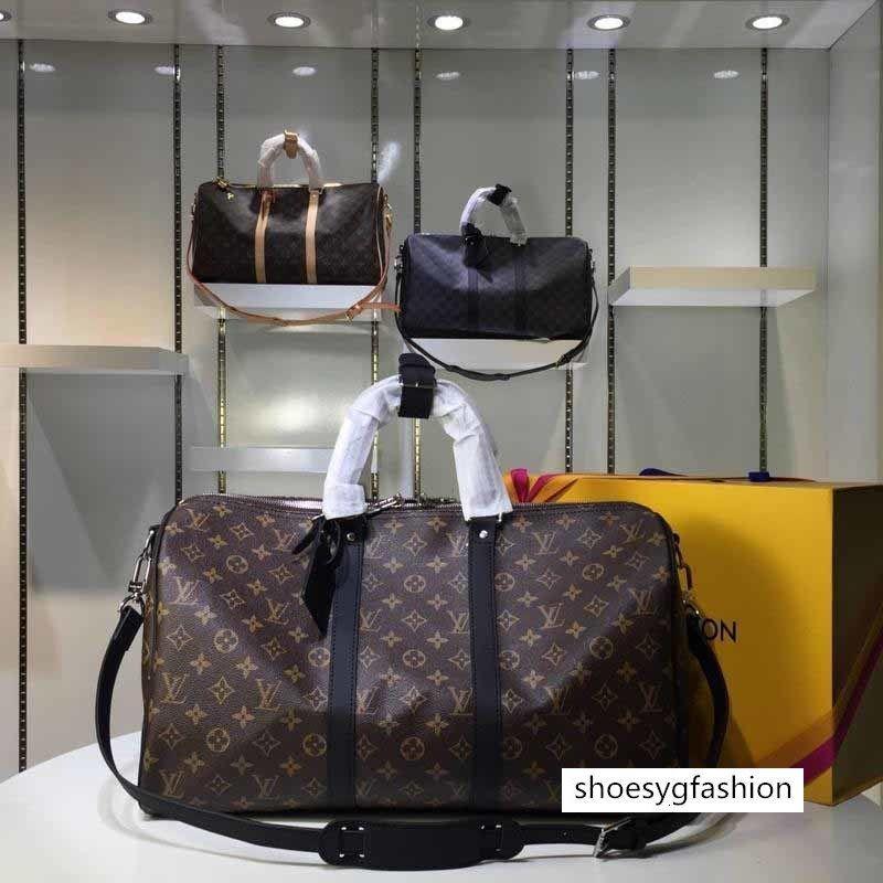 Yüksek kaliteli lüks tasarımcı erkek handbags'in çanta küresel sınırlı sayıda seyahat çantaları bayan çanta erkekler alışveriş torbaları 455.055
