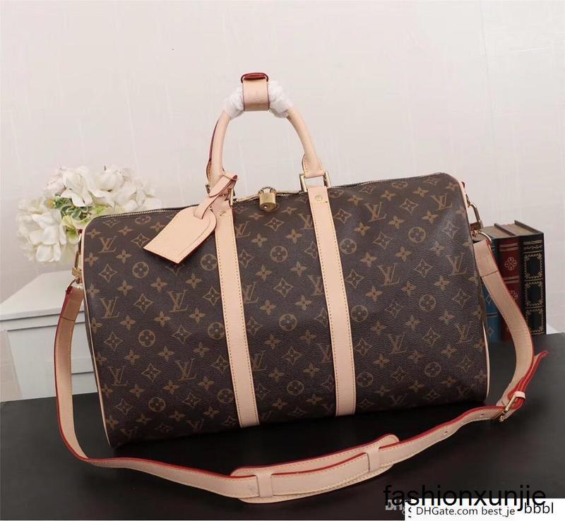 414181 clásico de tres tamaños de letras de color marrón hombres de cuero logotipo de tela de lona del estilo del envío bolso de las mujeres de gran tamaño del bolso M gratis