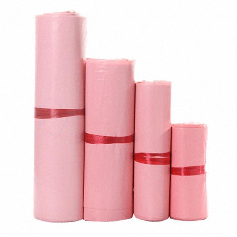 50Pcs nuova rosa traslucido corriere Borse addensare sacchetto impermeabile di immagazzinaggio Mailing sacchetto del PE Materiale busta Mailer postale 25 * 35cm STC3 #
