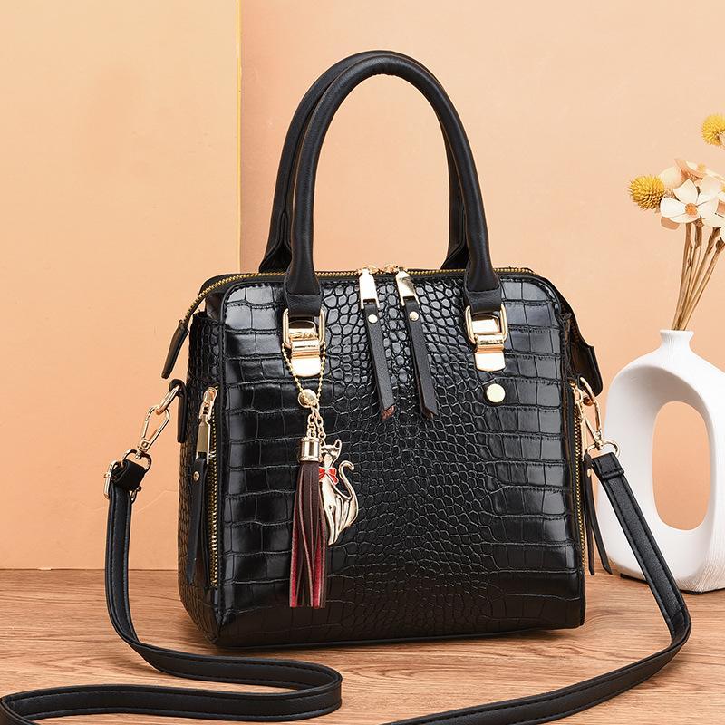 Weinlese PU-Leder-Dame-Handtaschen-Frauen Kuriertaschen TotesTassel Designer Umhängetasche Schultertasche Boston Handtaschen Hot Verkauf