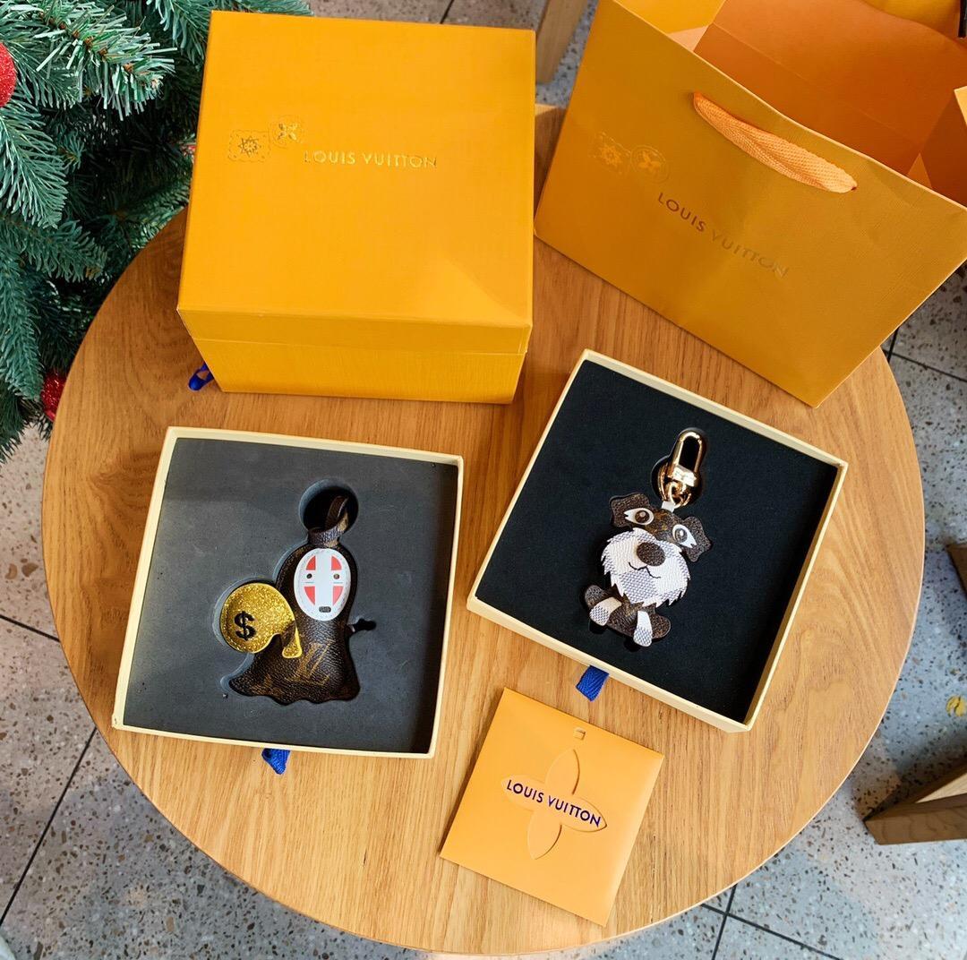 conception de dessin animé porte-clés classiques pour hommes, femmes beau sac de voiture en alliage d'or en cuir de porte-clefs keybuckle de porte-clés avec la boîte L044