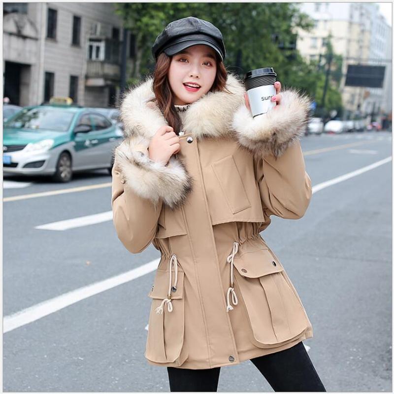 Manteau d'hiver en fausse fourrure Manteaux de neige Porter à capuchon épais coton rembourré en vrac hiver femme Vestes Parka Ukraine Casaco Feminino G713
