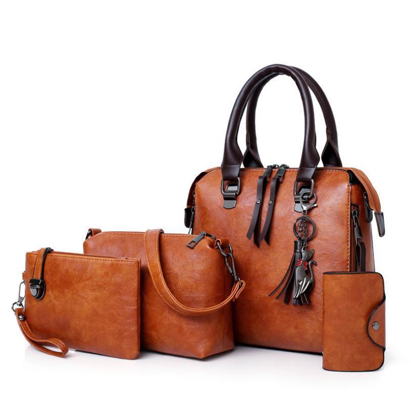 Женская сумка 2020 Модные Портативный Женская сумка ретро Простые Кожа PU Одноместный плеча Straddle Матери сумка