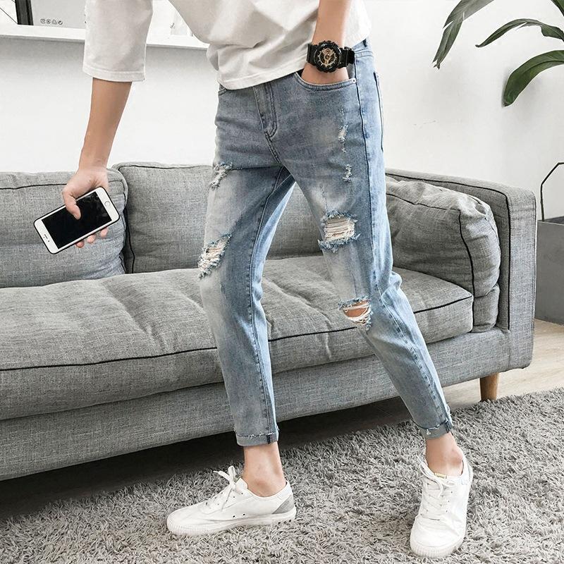 Gros 2020 Jeans de mode d'adolescents Casual hommes de la rue pieds minces pantalon déchiré sauvage nouveau lavage coréenne tendance mendiant pantalon