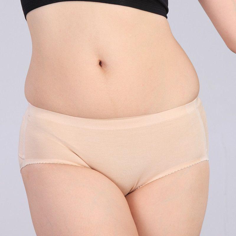 4pcs / lot de la piel de las mujeres Calzoncillos de algodón liso color bragas elástico Wasit Mujer 2020 Mujer Ropa OMU203005