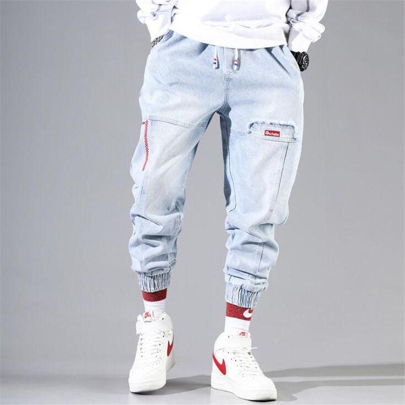 2020 Nuovo Jeans larghi uomini blu neri jeans strappati Hip hop lunghezza Streetwear Harem caviglia denim pantaloni a vita elastica pantaloni casuali