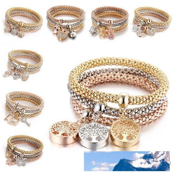 3pcs / set Elastic Kristall-Armband Diamant-Herz-Kronen-Baum des Lebens Schädel-Schmetterlings-Charme-Armband-Armband-Stulpe-Sets Schmuck Epacket Schiff