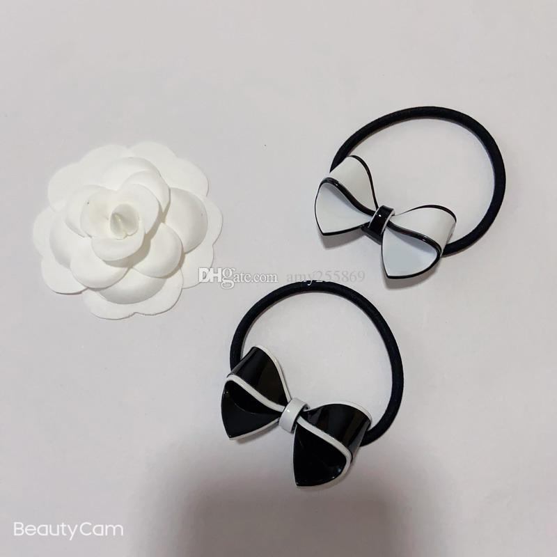 Fashion black and white acrylic bow elastic rubber band C symbol head rope for Ladies collection luxurious items hair ornament vip gift