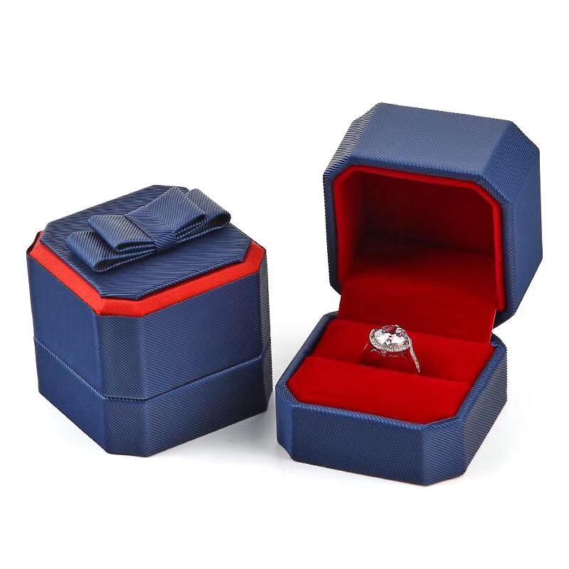 جديد مثمنة القوس PU الجلود والمجوهرات مربع اقتراح خاتم مربع هدية مربع التعبئة والتغليف