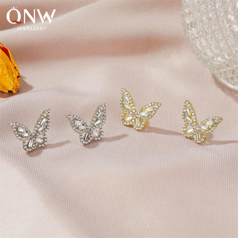 Nuevos pendientes clásicos, el temperamento sencilla, mariposa pendientes de circón, señoras suaves pendientes de cristal de estilo