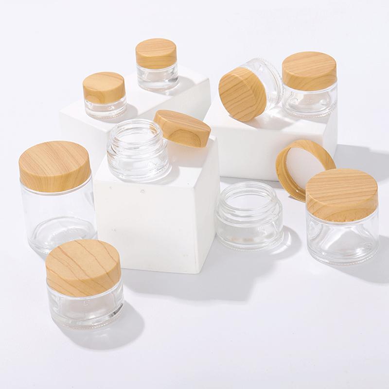جرة واضح زجاج زجاجات جولة كريم التجميل اليد الوجه التعبئة الحاويات 5G 10G 15G 20G 25G 30G 50G 100G مع غطاء بلاستيكي الحبوب الخشب