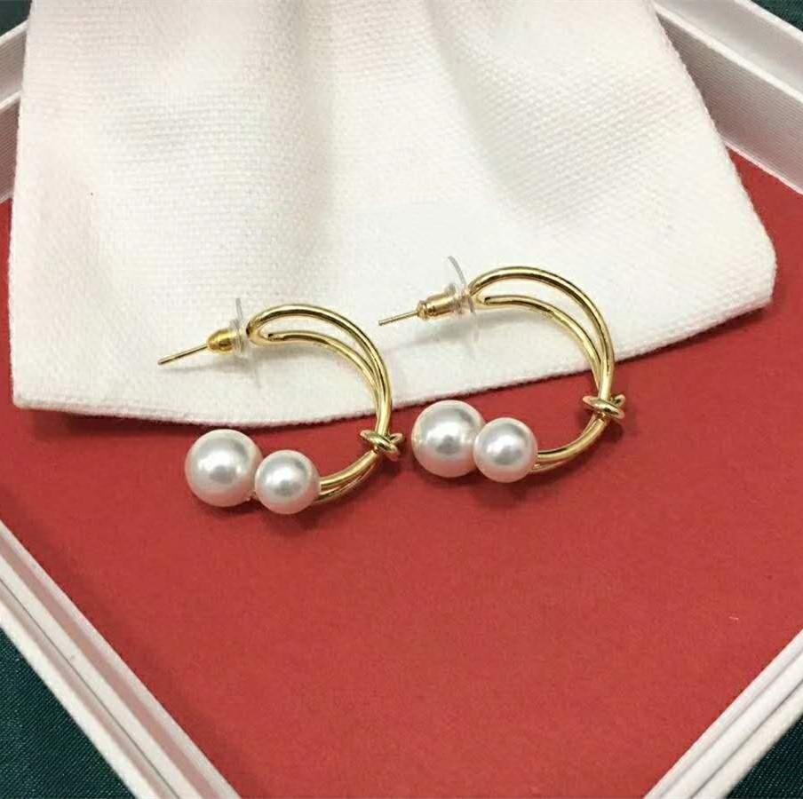 Les meilleurs modèles de vente d'explosion simples anneau torsadé boucles d'oreilles de créateurs sauvages design luxe femmes bijoux boucles