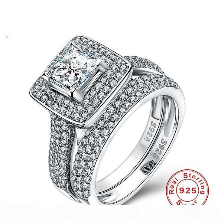 Größe 5-10 Luxuxschmucksachen Reines 100% 925 Sterlingsilber-Prinzessin Cut White Sapphire Gemstones CZ Diamant-Frauen-Hochzeits-Paar-Ring-Satz-Geschenk