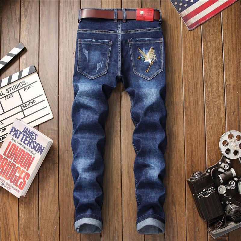 Nueva moda estilo coreano personalizada pantalones apretados de los pantalones vaqueros y los pantalones vaqueros de los hombres bordados de la marca de moda agujero de perforación-moda mendigo flaco trou