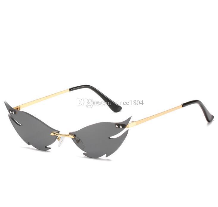 Estilo personalidad estilo gafas de sol sin rimo irregular exagerado mujeres disparando gafas tiburones nueva calle gafas de sol wxkka