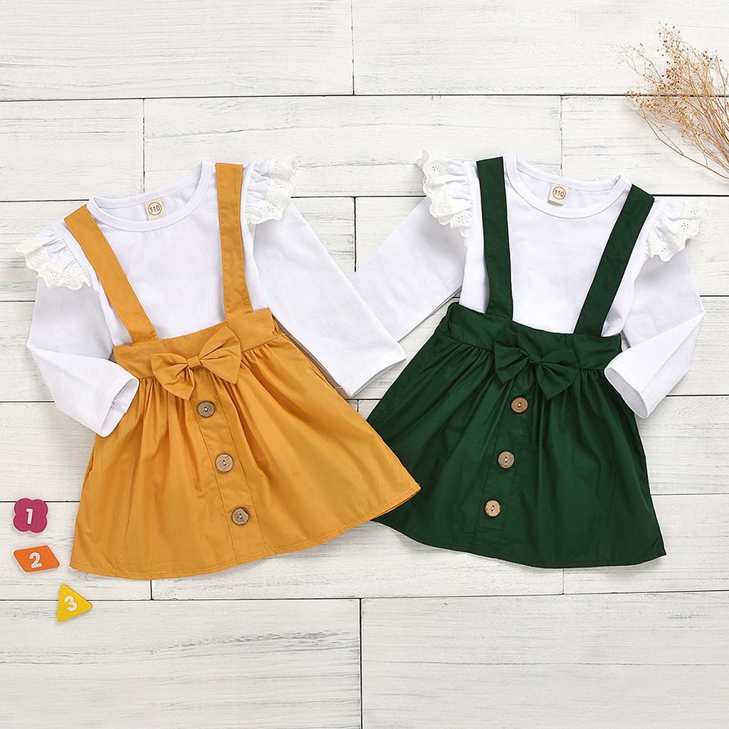 Más nueva manera Bebé ropa de la muchacha del O-Cuello de manga larga sólido volante Tops botón pajarita falda 2pcs de trajes de verano de la ropa