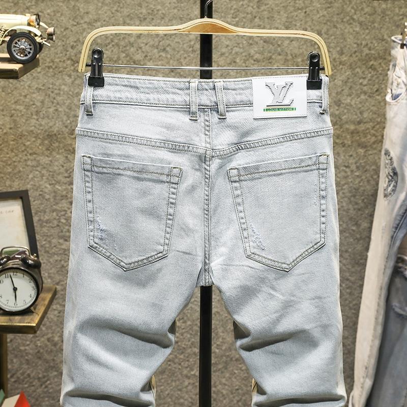2020 Frühling und Sommer neue Art und Diamant-Jeans zerrissene Jeans der Männer heiße Diamant helle Farbe koreanische Art dünne High-End-modische Stretch-Füße